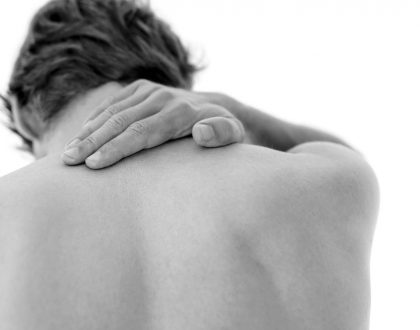 A man with a sore neck helped by our Brookfield Chiropractor